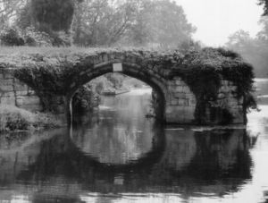 Old Bridge In Grayscale